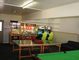 arcade, ping pong and billiard tables in the game room