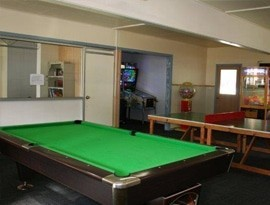 billiard table in the game room